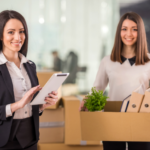 Businesswomen with Moving Boxes | 3GuysMoving.com