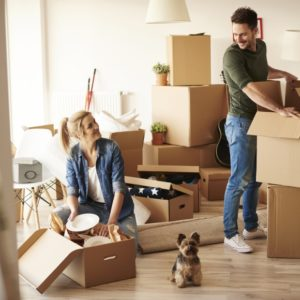 young couple packing moving boxes | 3GuysMoving.com