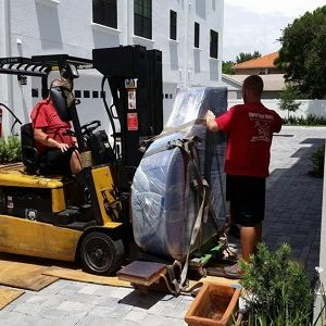 Two Men Carefully Moving a Piano | 3GuysMoving.com