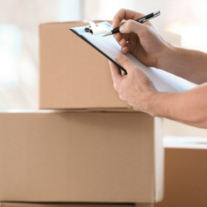 Professional Packer with Clipboard and Moving Boxes | 3GuysMoving.com